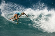 Holly Beck surfing Rocky Point on Oahu while on tour